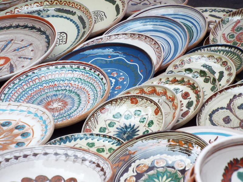 Painted traditional clay plates from horezu, romania. Handmade decorative traditional clay plates souvenir from horezu,painted with various traditional motifs stock image
