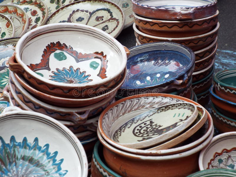 Painted traditional clay plates from horezu, romania. Handmade decorative traditional clay plates souvenir from horezu,painted with various traditional motifs royalty free stock images