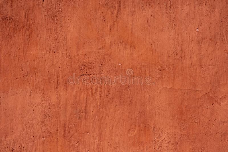 Painted wall background. Highly detailed red color stucco wall background stock images