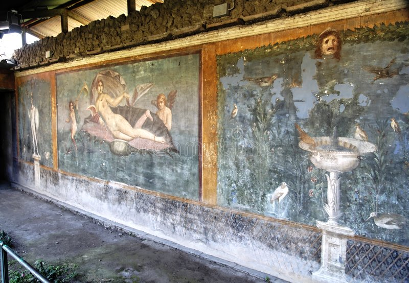 Painted Wall Pompeii. A painted wall in the garden of the ruins of an ancient roman house in Pompeii. God Venus in a seashell in the middle painting and a royalty free stock images