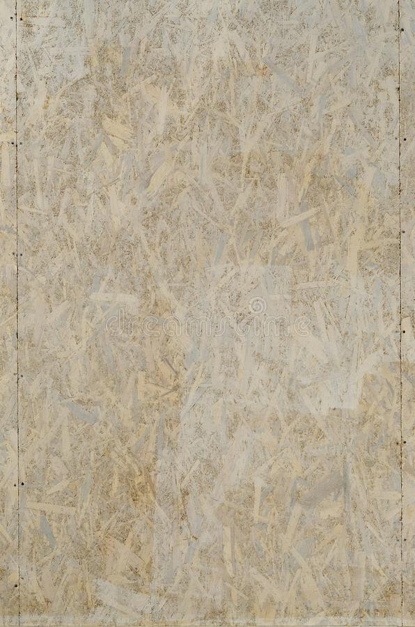 Painted white oriented OSB chipboard texture. Texture, osb, board Top view of OSB wood veneer stained wall backgroun. D stock photos