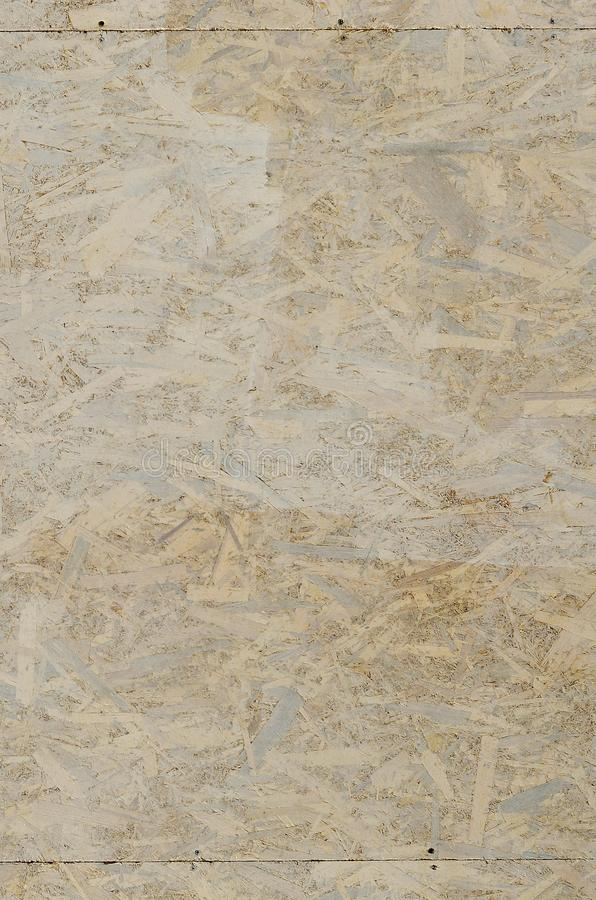 Painted white oriented OSB chipboard texture. Texture, osb, board Top view of OSB wood veneer stained wall backgroun. D stock images
