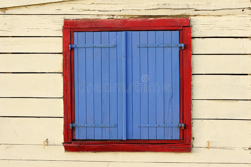 Painted window shutters on bea stock image