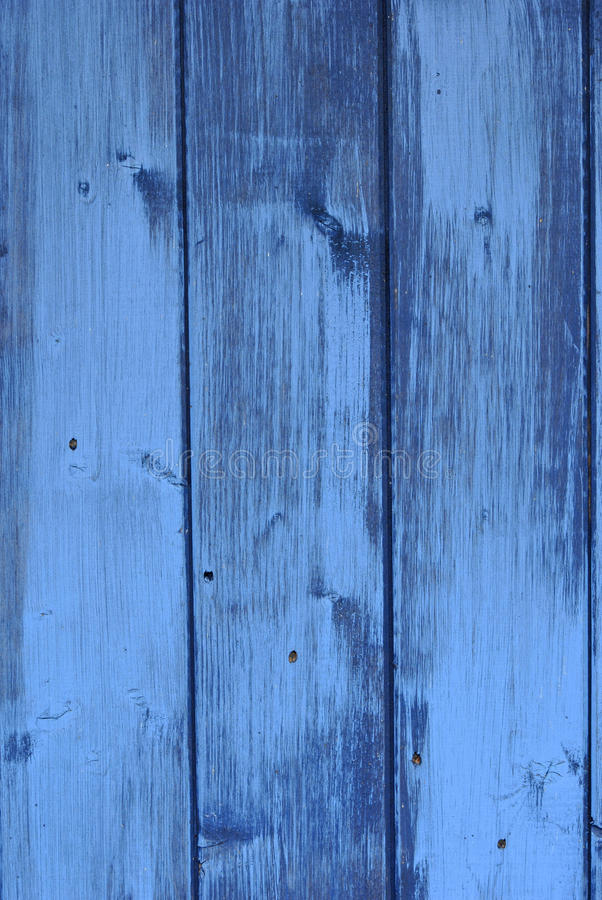 Painted wood in blue. Closeup of the painted wood in blue color stock image