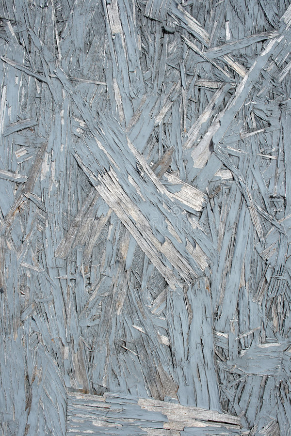 Painted wood chipboard texture. Wood chipboard texture, with blue peeling paint royalty free stock photo