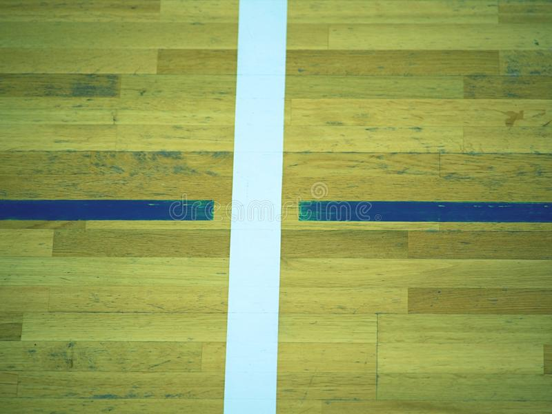 Painted wood floor ,parquet hardwood in basketball court. The floor viewed from above. For design texture pattern and background stock photo