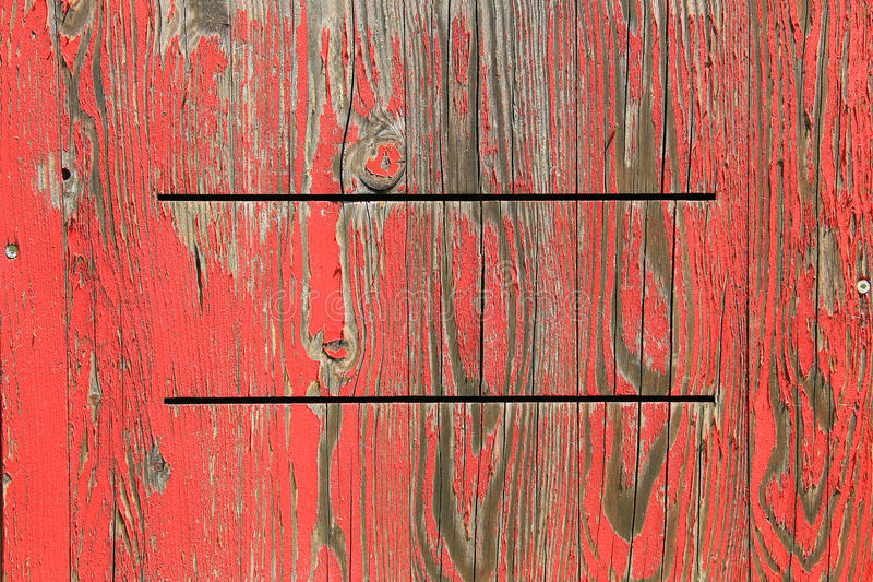 Painted wooden background with exfoliated red color stock photography