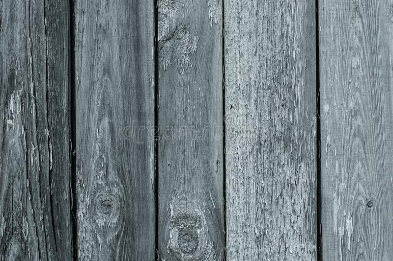 Painted wooden fence. Old gray wood planks, cracked grunge texture. Shabby timber in vintage style. Abstract pattern. Painted wooden fence. Old gray wood planks royalty free stock images
