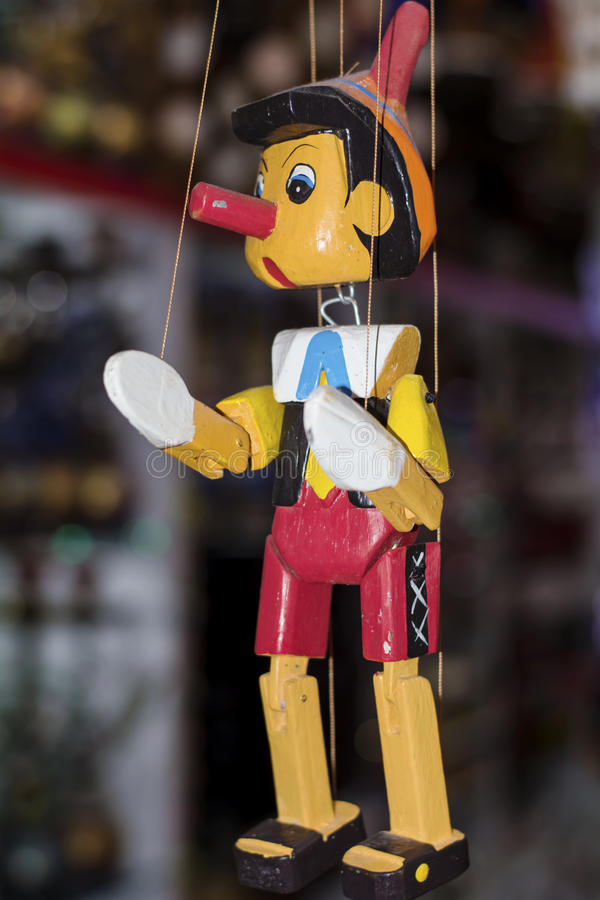 Painted wooden marionette doll of the figure of Pinocchio stock images