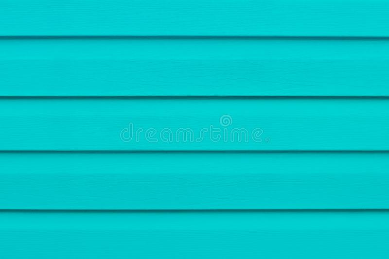 Painted wooden table in lines. Bright turquoise wood boards. Green striped panel, surface, plank timber backdrop. Wooden slats. Co royalty free stock photo