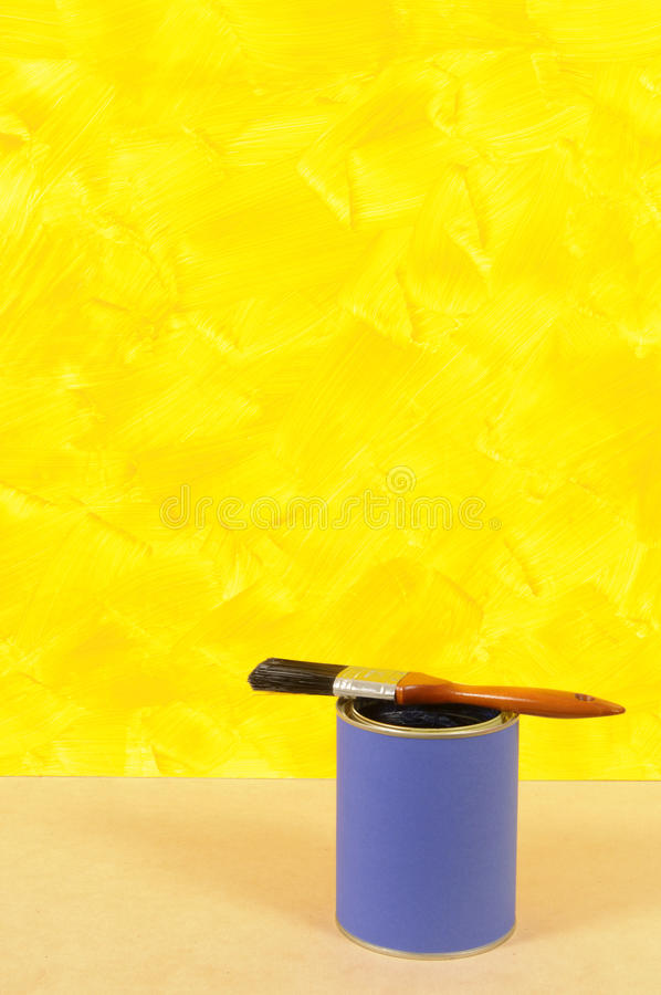Painting A Wall : Painted Yellow Wall With Blue Paint Tin And ...