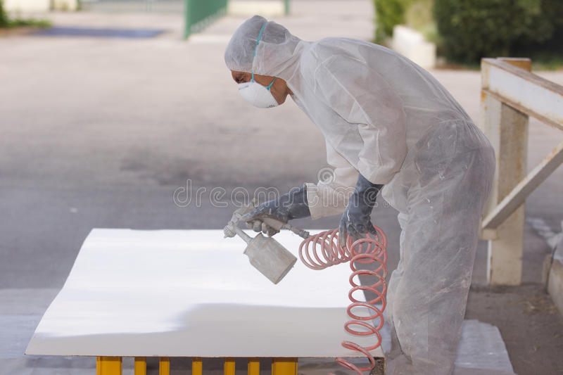Painter. A painter at work in his construction site royalty free stock images