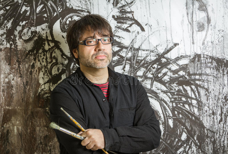 Painter artist posing in front of paint stock photos