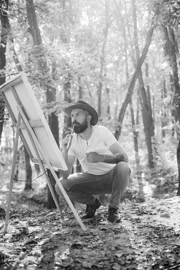 Painter artist forest. Art concept. Painting in nature. Start new picture. Painter with easel and canvas. Bearded man. Painter looking for inspiration autumn stock photography