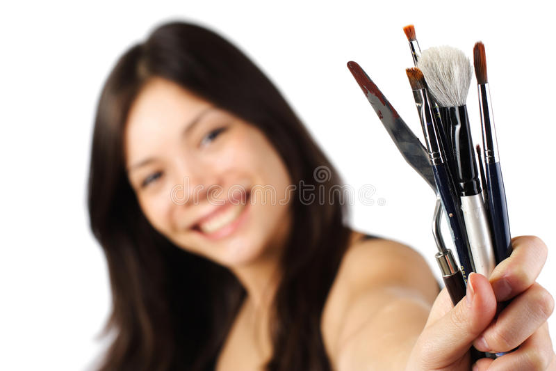 Painter artist with paint brushes royalty free stock photography