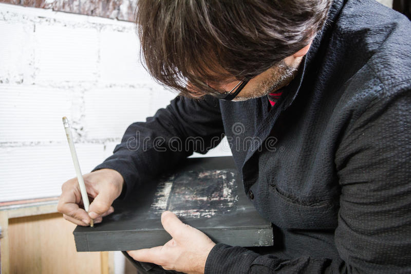Painter artist signing oil canvas royalty free stock photography