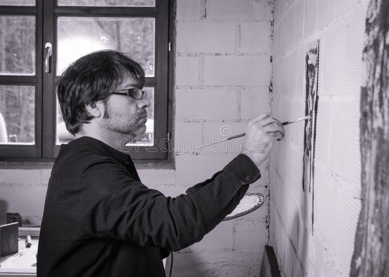 Painter artist working on a oil canvas stock images