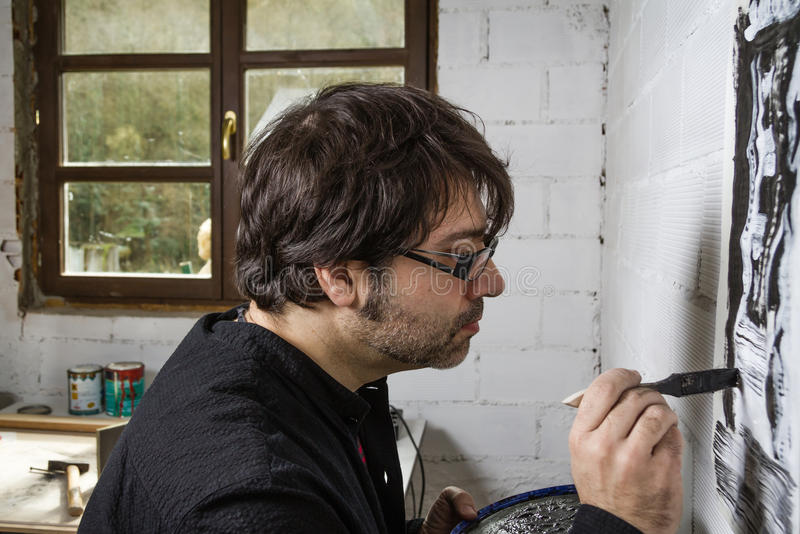 Painter artist working on a oil canvas royalty free stock photos