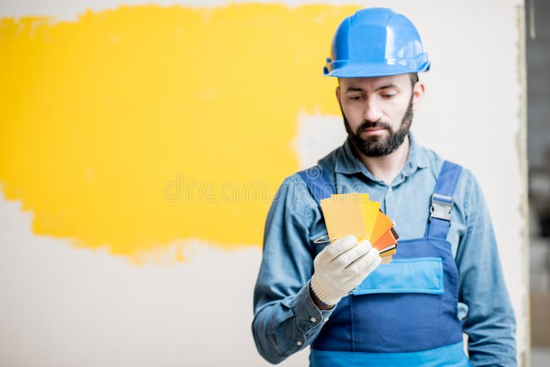 Painter with color swatches indoors royalty free stock photos