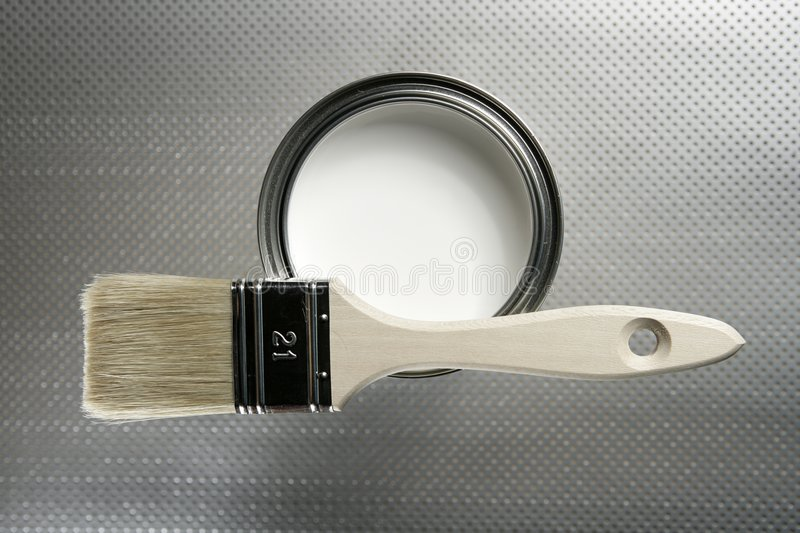 Painter brush and white paint tin stock images
