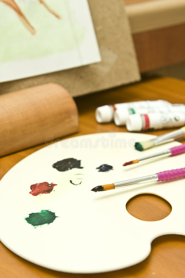 Painter Color palette. Watercolors and painting in the background royalty free stock photo