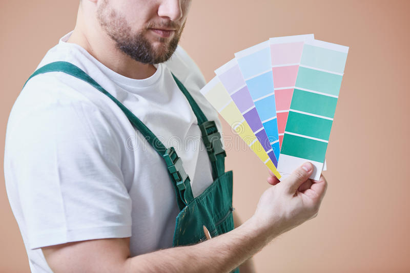 Painter with color palettes royalty free stock image