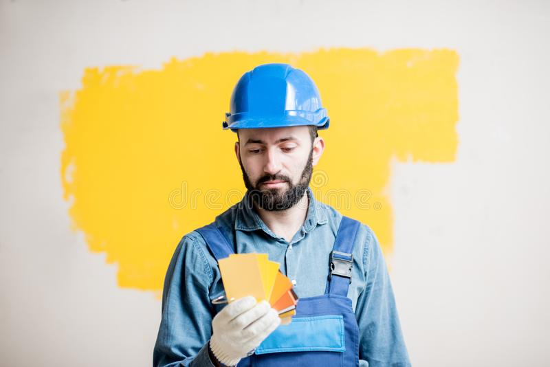 Painter with color swatches indoors royalty free stock photography