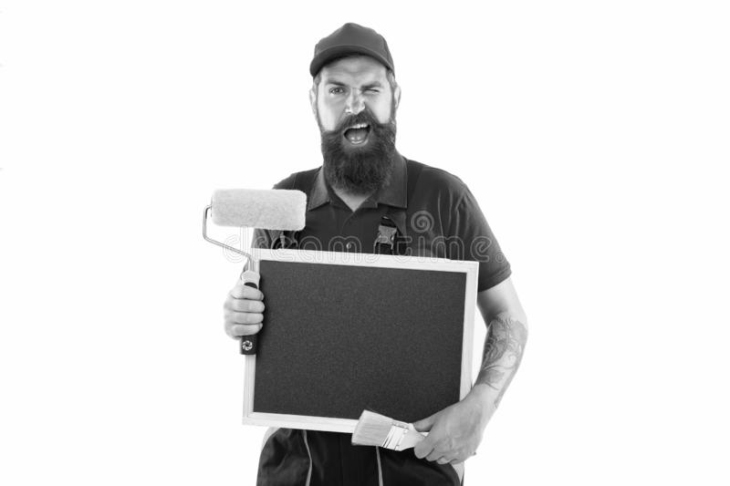 Painter and decorator school information. Painter hold empty information board. Bearded man with blank blackboard royalty free stock photo