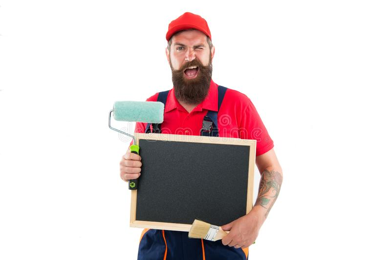 Painter and decorator school information. Painter hold empty information board. Bearded man with blank blackboard royalty free stock photography