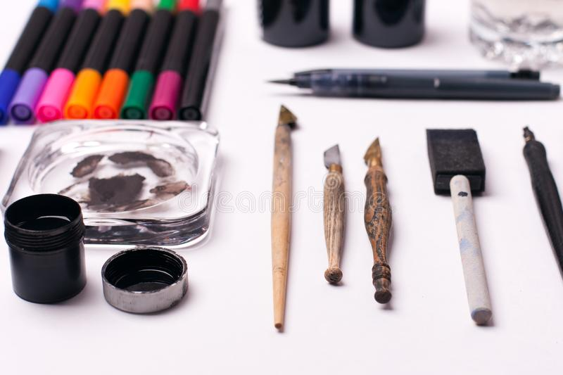 Painter, graphic designer or calligraphy work space, different kind of tools, brushes, marker and pen, place ready to create now d royalty free stock photography