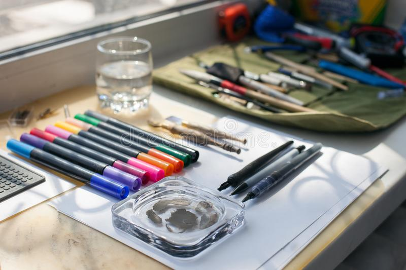 Painter, graphic designer or calligraphy work space, different kind of tools, brushes, marker and pen, place ready to create now d stock photos