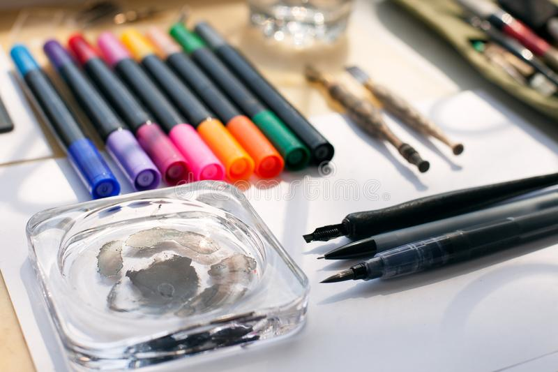 Painter, graphic designer or calligraphy work space, different kind of tools, brushes, marker and pen, place ready to create now d stock image