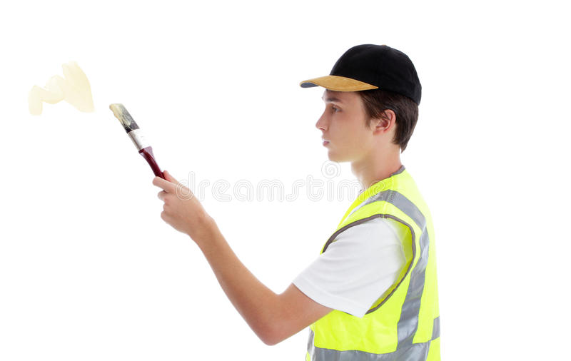 Painter handyman applying paint. A young apprentice handyman painter applying some paint. White background stock images