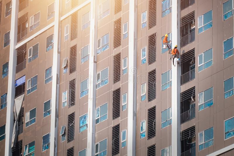 painter hanging painting color on building royalty free stock photos