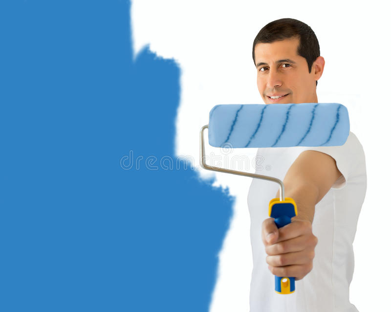 Painter and his blue roller stock photo