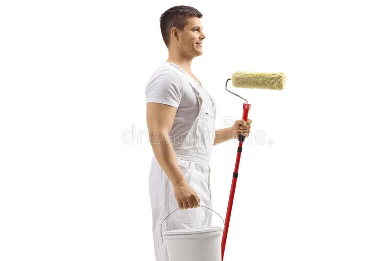 Painter holding a bucket and a paint roller stock image