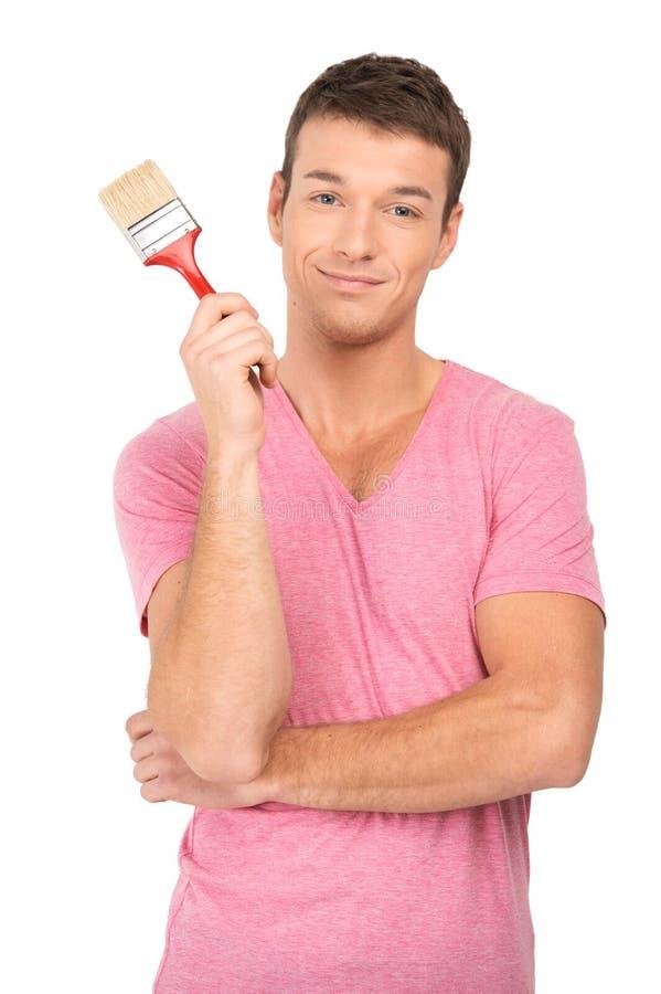 Painter holding paintbrush on white background. royalty free stock photos