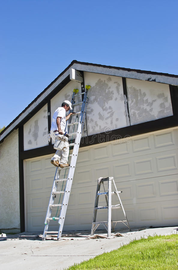 Painter on Ladder. Painter makes his way up the ladder royalty free stock images
