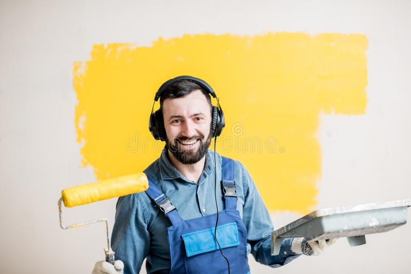 Painter listening to the music during the work stock photos