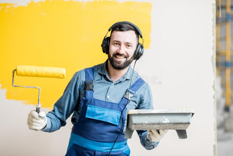Painter listening to the music during the work royalty free stock photo