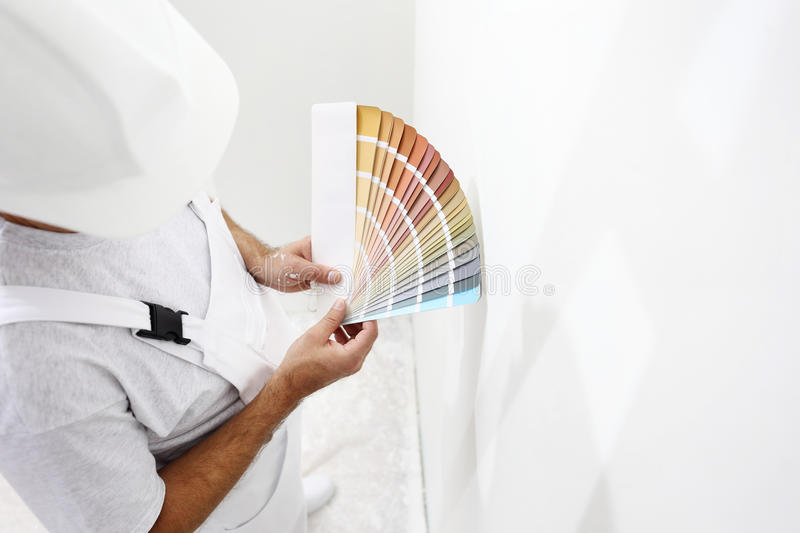 Painter man with color swatches in your hand stock photos
