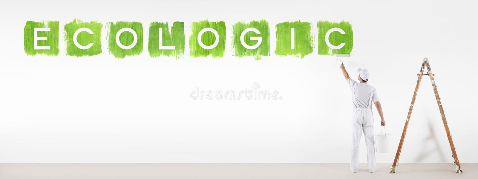 Painter man painting green color ecologic text isolated on wall. Painter man painting green color ecologic text isolated on blank white wall background, banner royalty free stock images