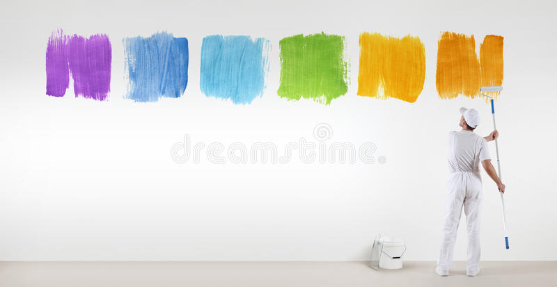 Painter man painting varied colors symbol isolated on wall. Painter man painting varied colors symbol isolated on blank white wall background, banner web stock images