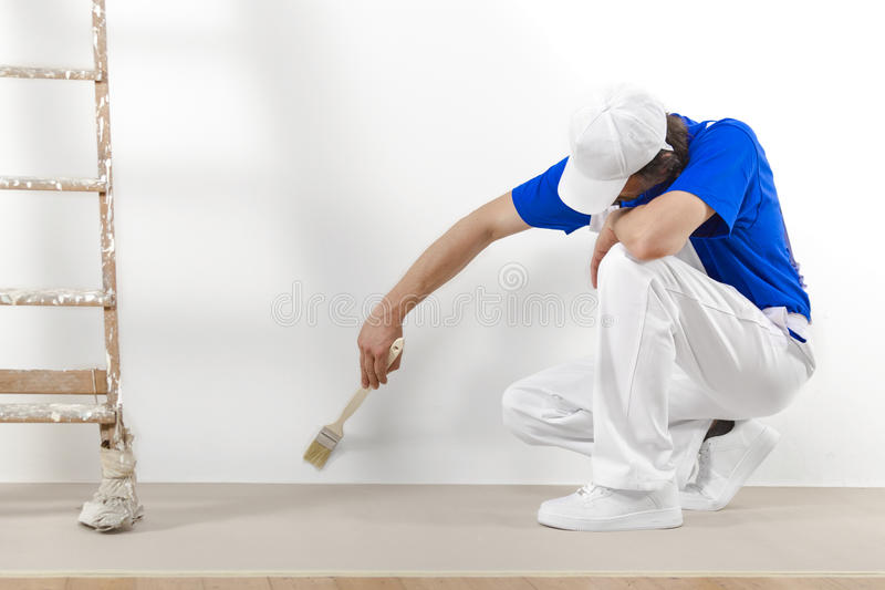 Painter man at work with brush royalty free stock image