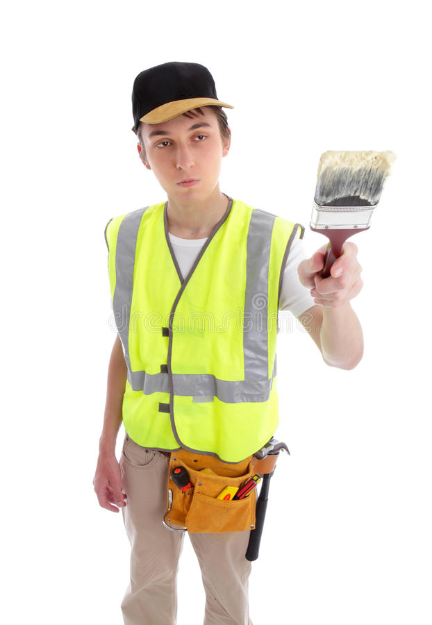 Painter with paint brush. A painter handyman or builder using a paintbrush. White background royalty free stock photo