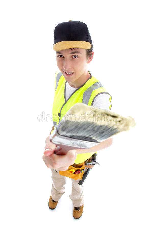 Painter with paint brush. Painter standing and holding using a paintbrush. White background royalty free stock image