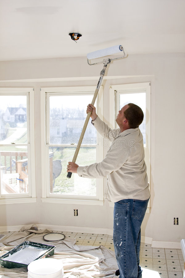 Painter Rolling Ceilings royalty free stock photos