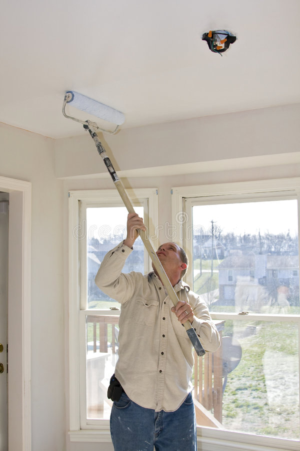 Painter Rolling Ceilings stock images