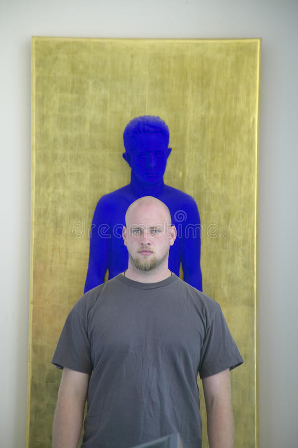Painter stands in front of sculpture of Yves Klein, the Museum of Modern and Contemporary Art of Nice, Nice, France royalty free stock photos
