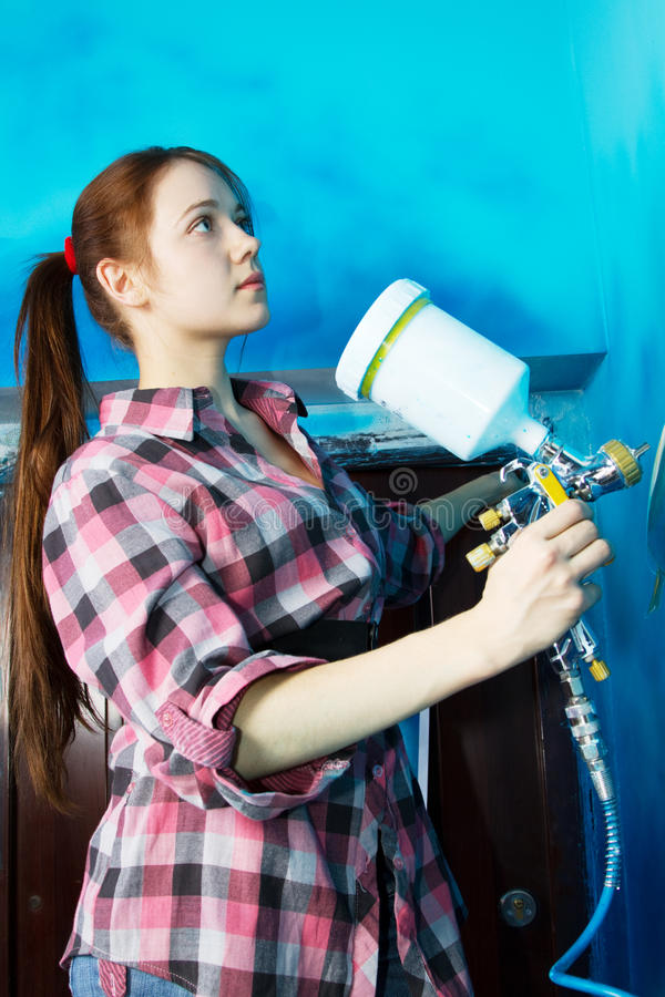Painter at work, painting a home interior. Professional painter at work, painting a home interior royalty free stock photography